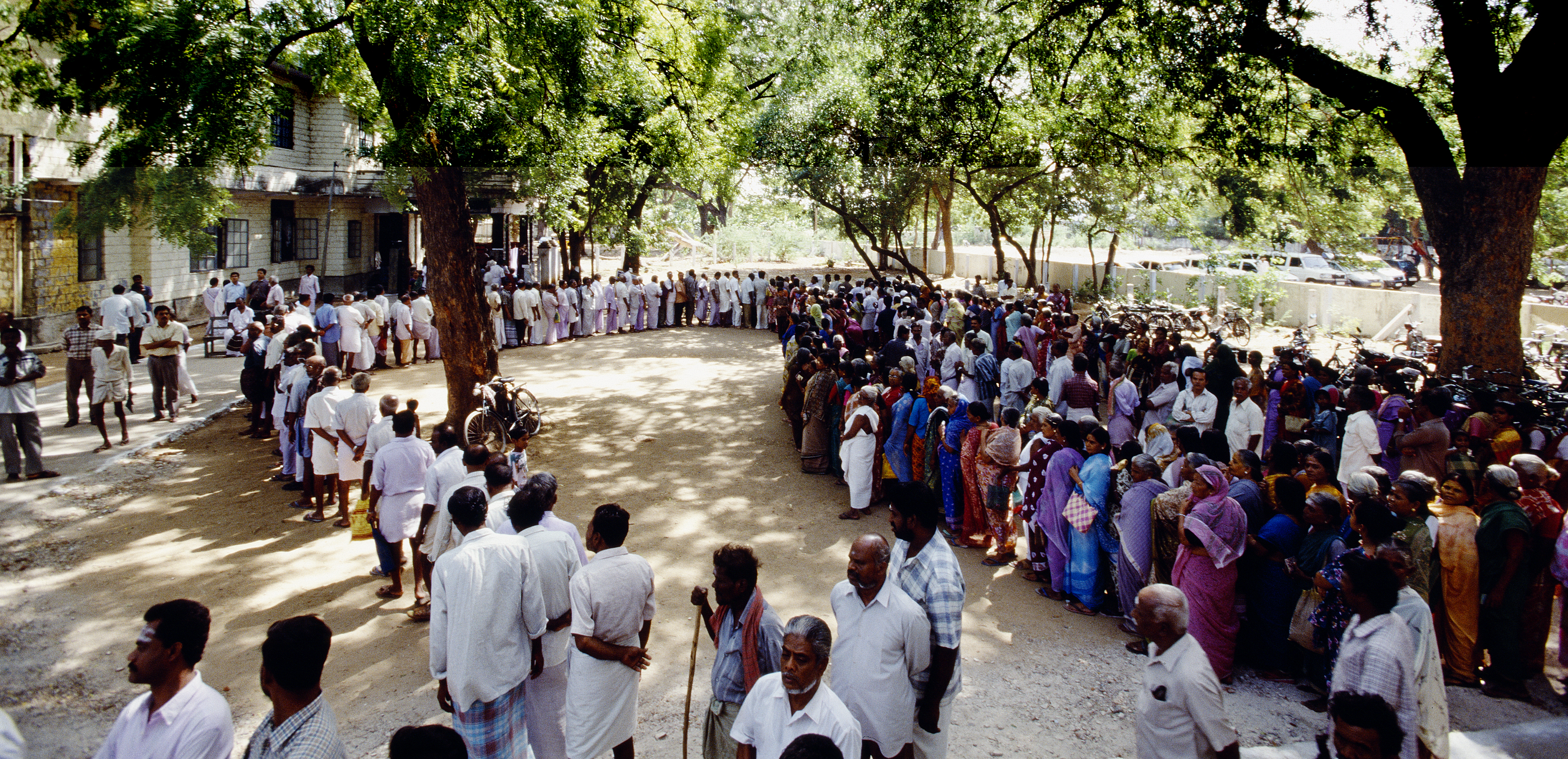 A queue of people in India.