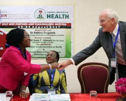 Dr Evelyn Ngige (left) greets Anders Dejgaard at the podium of 'Diabetes and NCDs in Nigeria'